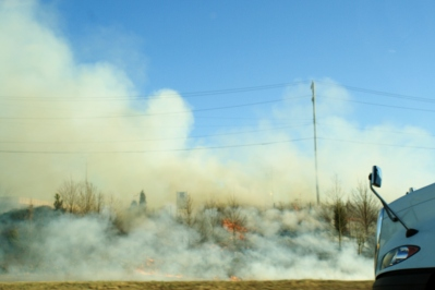 Brush fire on the side of the highway
