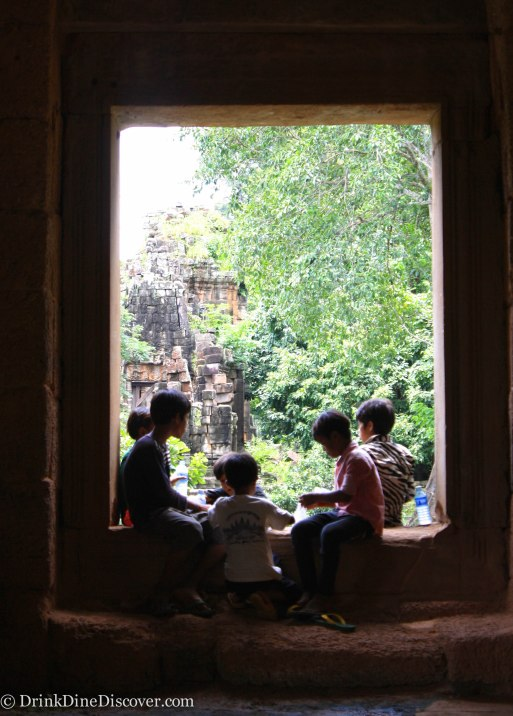 Local kids eating lunch among the ruins